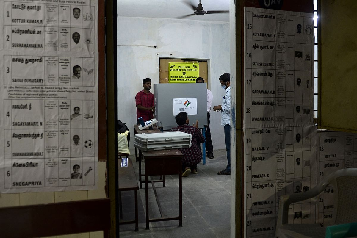 Election officials prepare polling stations on the eve of the Tamil Nadu state legislative assembly elections, in Chennai on April 5, 2021.