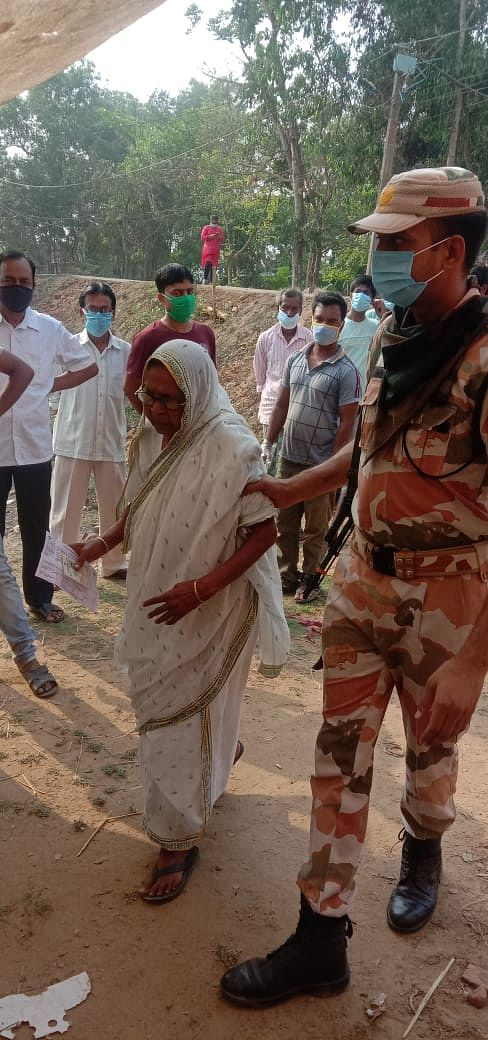 An ITBP jawan helping a senior citizen in the Hoogly rural constituency during the third phase of West Bengal Assembly polls on April 6, 2021.