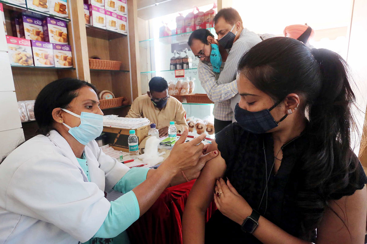 A young woman in Bhopal receives a Covishield vaccine at a special vaccination camp as drive for people above 45 years of age has begun all over the country on Thursday.