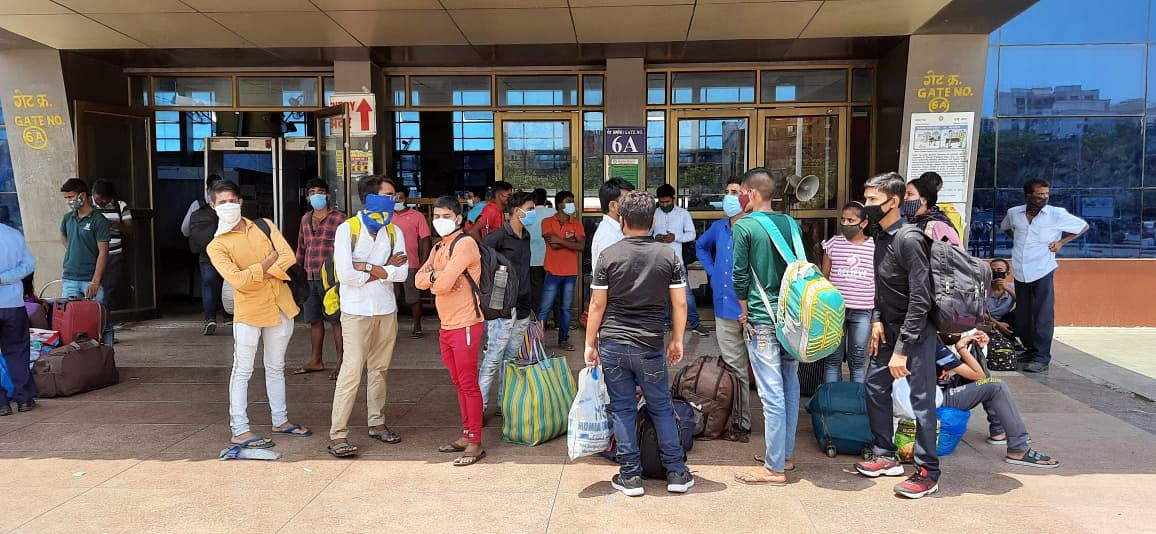 Migrant workers arrive at Lokmanya Tilak Terminus as they head to their hometowns along with families amidst rising coronavirus cases and lockdown in Mumbai.