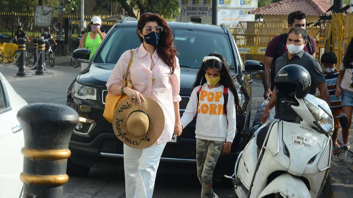 In Pics: Twinkle Khanna has something 'funny' written on her hat as she steps out with daughter Nitara