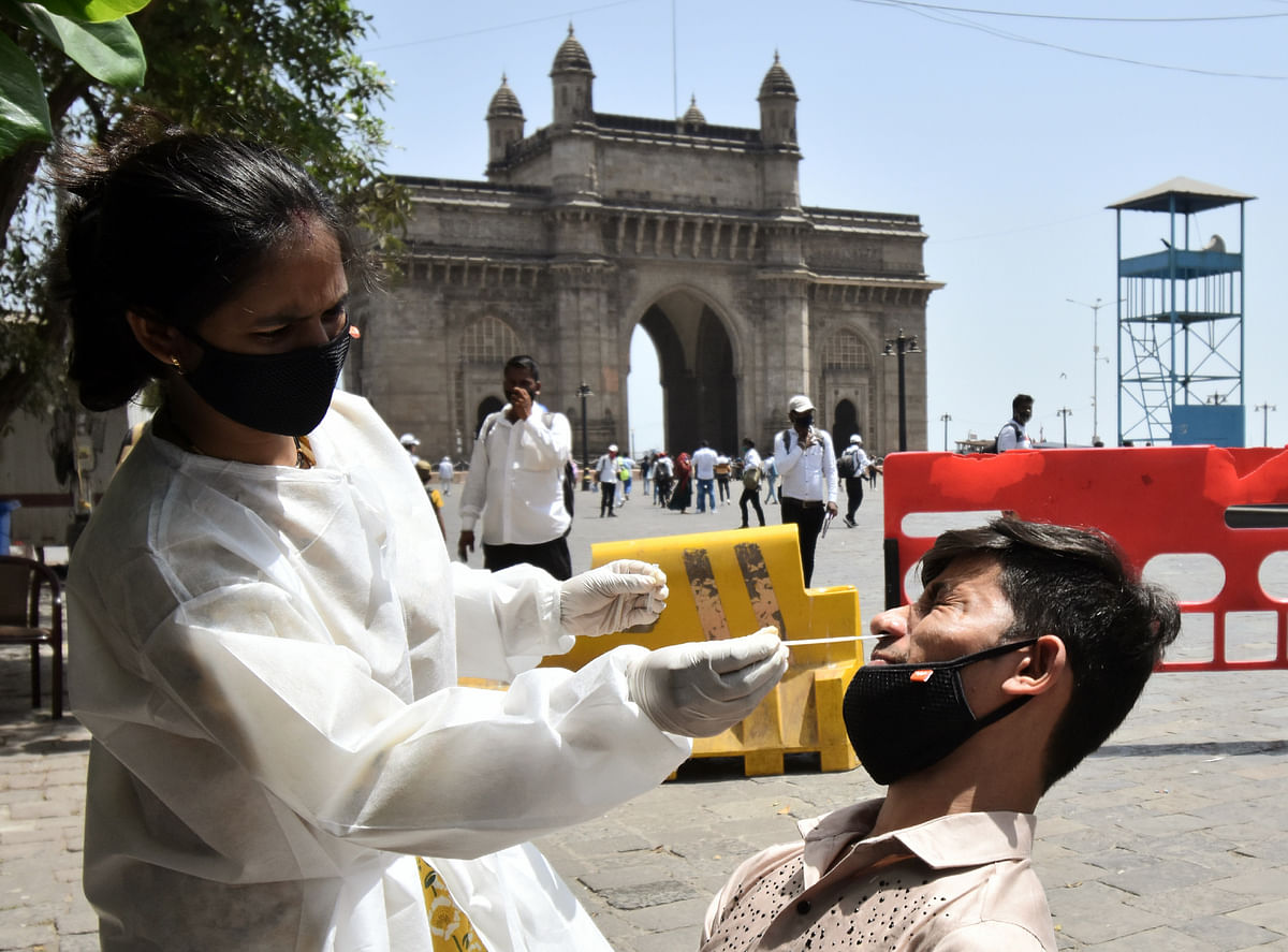 Maharashtra, April 02 (ANI): A health care worker collects a nasal sample from a man for COVID-19 testing, amid the rise in cases, in Mumbai on Friday.