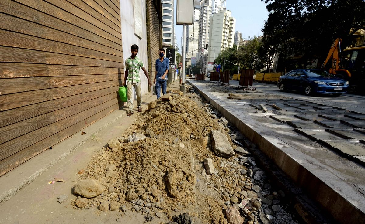 Hughes Road repairs leave no space for passerbys to walk