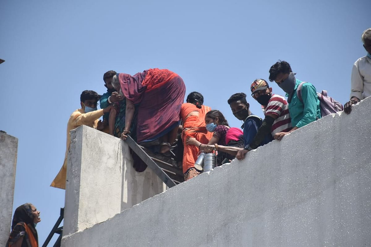 A woman jumps to next building after fire broke at Patidar hospital on Sunday