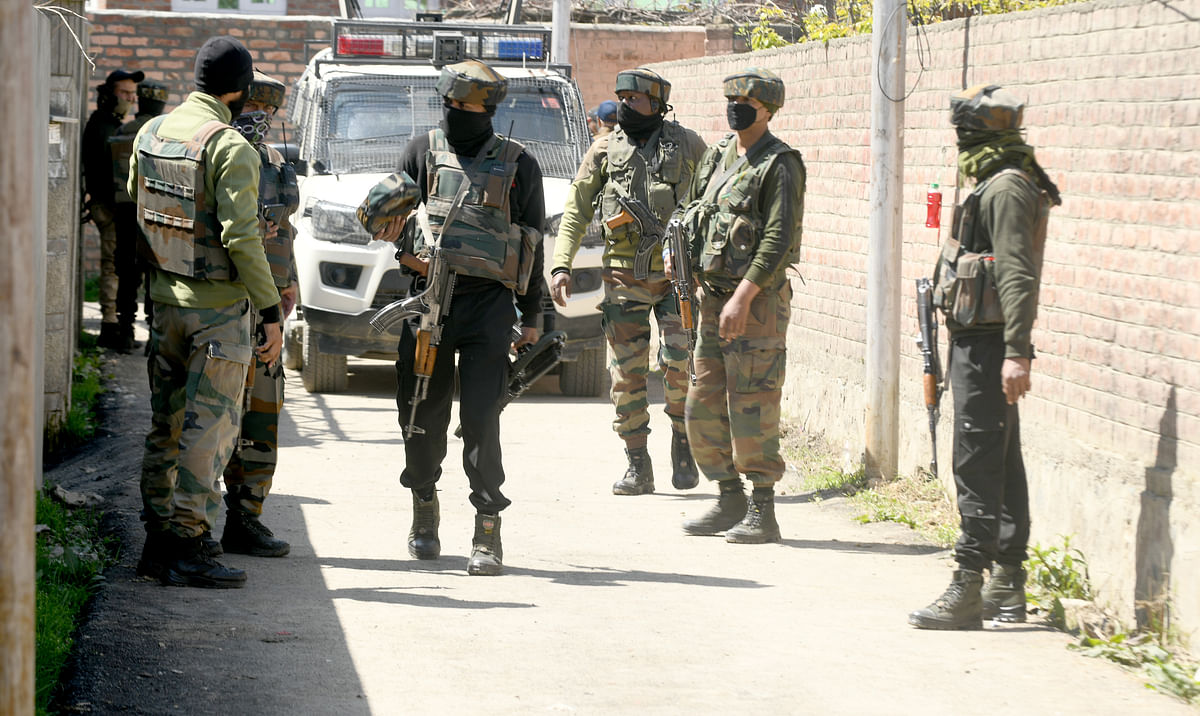 Senior security personnel arrive at the spot where suspected militants fired at BJP leader Anwar Khan's residence in outskirts of Srinagar.