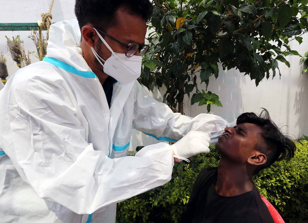 Sample being collected for corona testing in the state capital, Bhopal, on Monday.