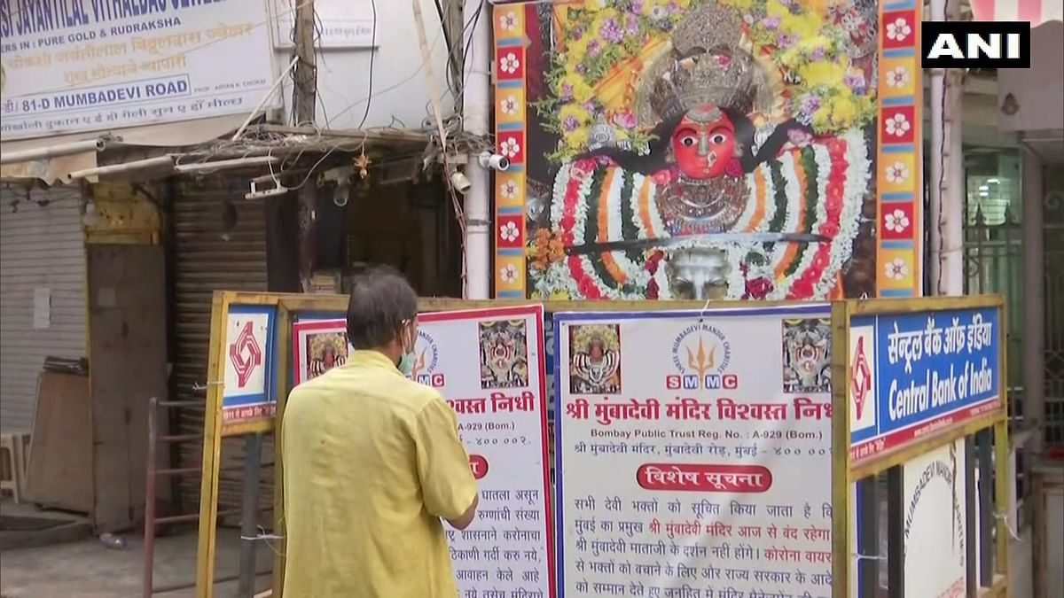 Mumbai: Devotees pray outside Mumba Devi Temple on Ashtami amid COVID-19 restrictions