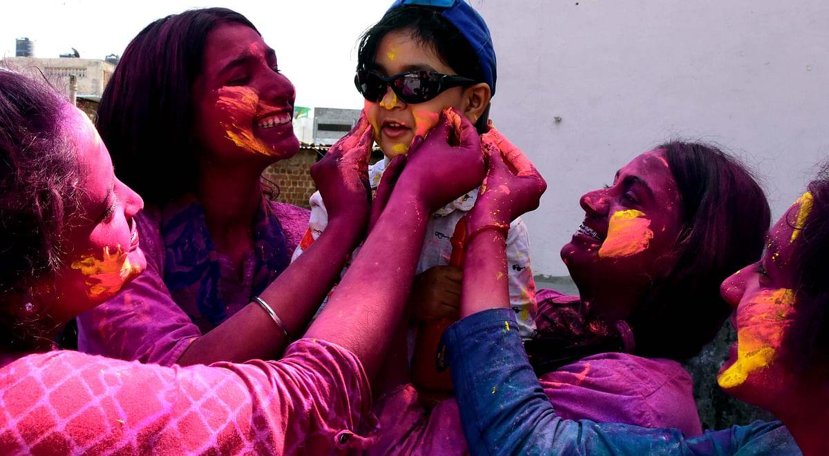 Family members celebrating Rangpanchami in New Bhopal on Friday