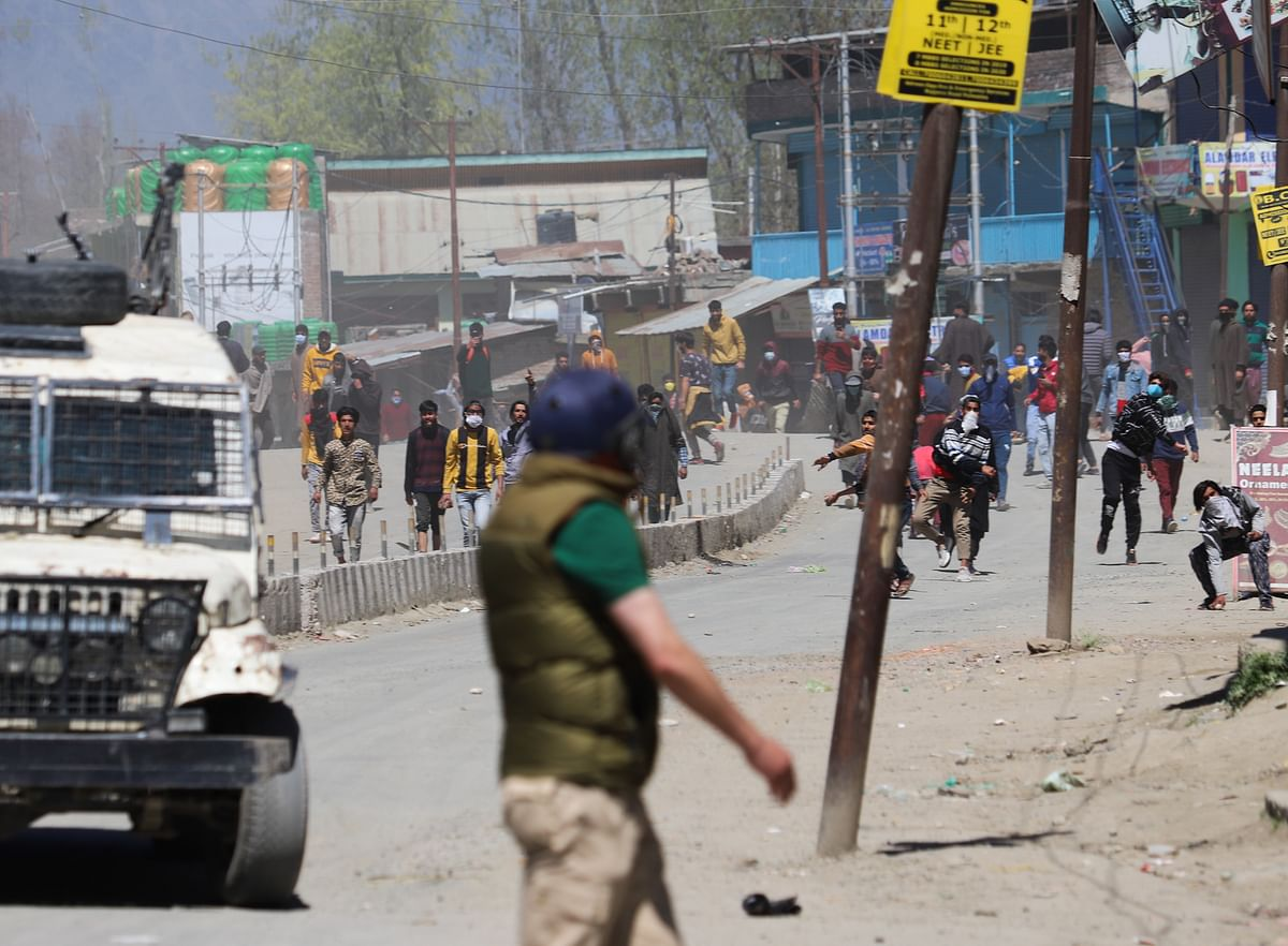 Kashmiri protesters clash with government forces near an encounter site during an encounter with militants in Pulwama district of South Kashmir.