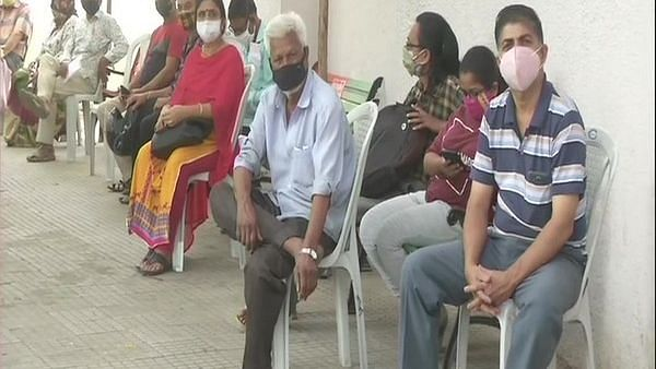 People gather at Nagpur health facility to take COVID-19 vaccine shot