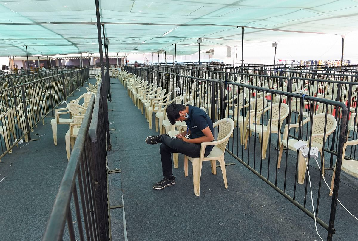 A volunteer sits in an empty waiting area outside a Covid-19 vaccination centre as vaccination was stopped due to shortage of vaccine supplies, in Mumbai on April 9, 2021