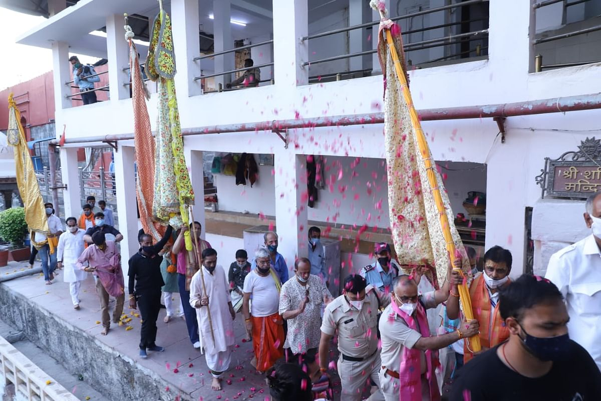 Flags being taken out for the traditional worship at Mahakal Temple in Ujjain on Friday