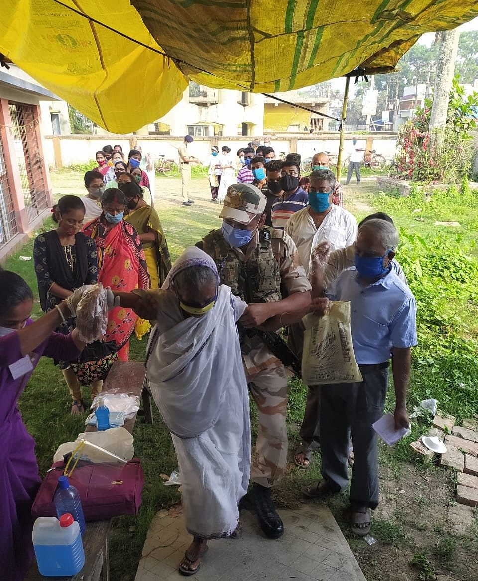 ITBP jawans helping senior citizens in Dakshin Barasat, District South 24 Pargana during the third phase of West Bengal Assembly polls on April 6, 2021.