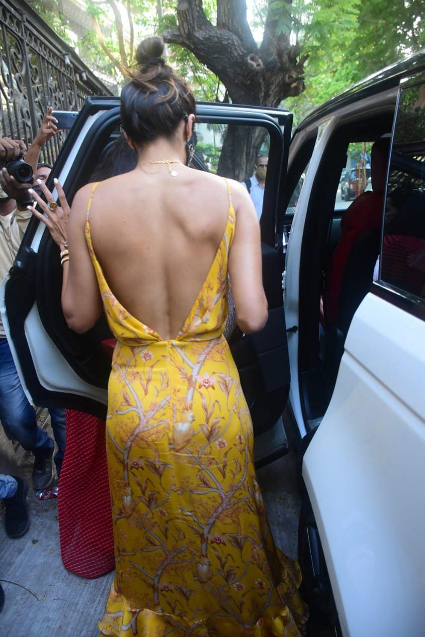 FPJ Fashion Police: Malaika Arora's sexy backless daffodil print dress costs only Rs 5,000!