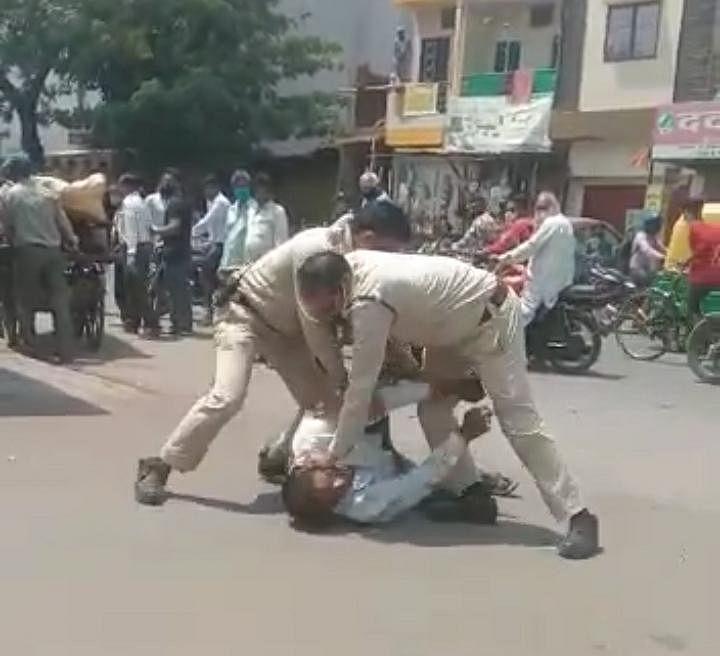 Cops beating the violator
