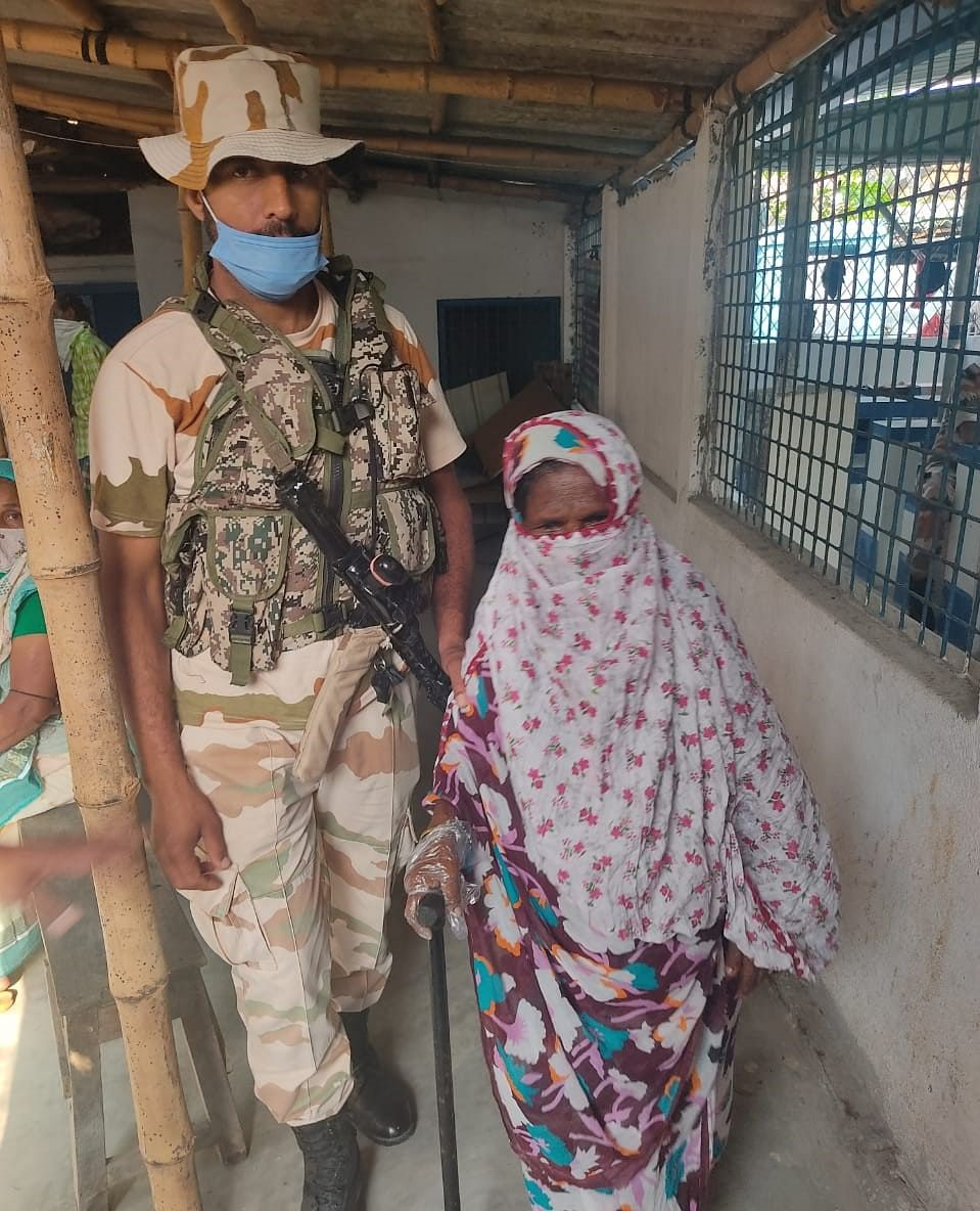 ITBP jawans helping citizens in Dakshin Barasat, District South 24 Pargana during the third phase of West Bengal Assembly polls on April 6, 2021.