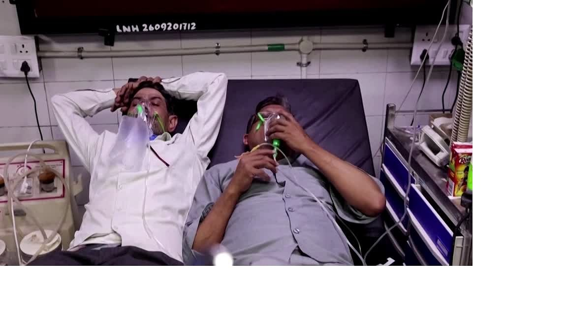 Two patients forced to share a bed at a Delhi hospital, last week