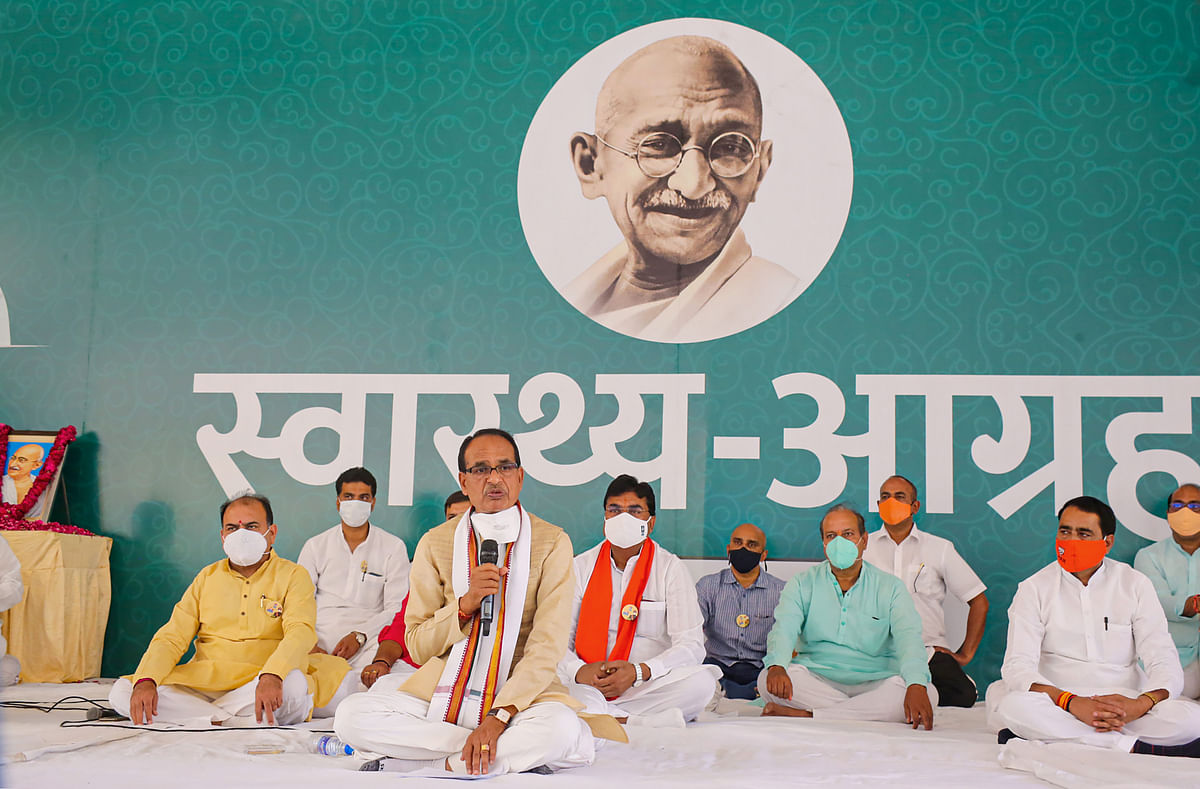 Madhya Pradesh Chief Minister Shivraj Singh Chouhan speaks during a health request programme to create awareness on COVID-19, at Gandhi statue in Bhopal on Wednesday
