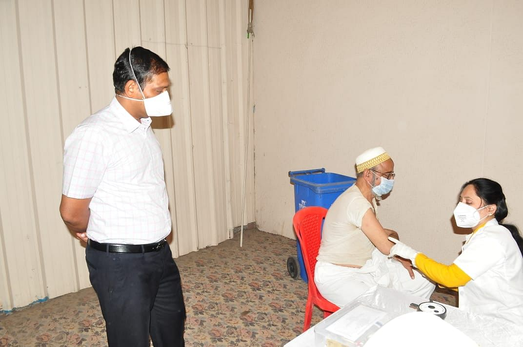 A beneficiary gets a vaccination under collector's watch at a health facility in Ujjain on Friday