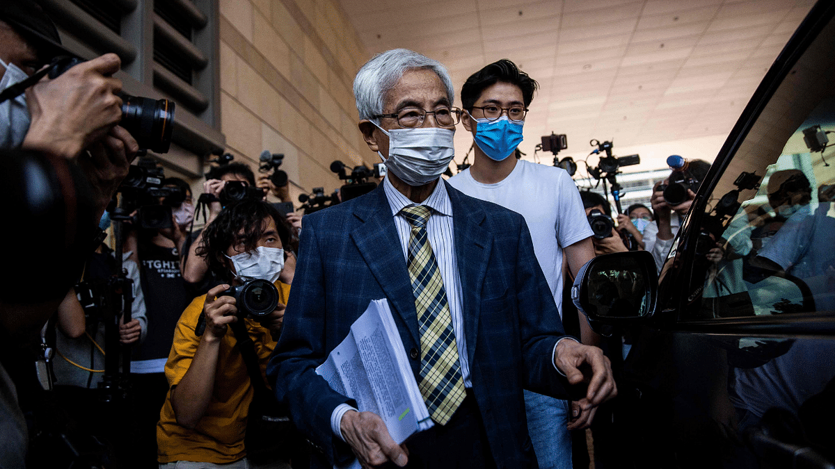 Former lawmaker and barrister Martin Lee (C) leaves West Kowloon court in Hong Kong on April 1, 2021, after being found guilty of organising an unauthorised assembly on August 18, 2019.