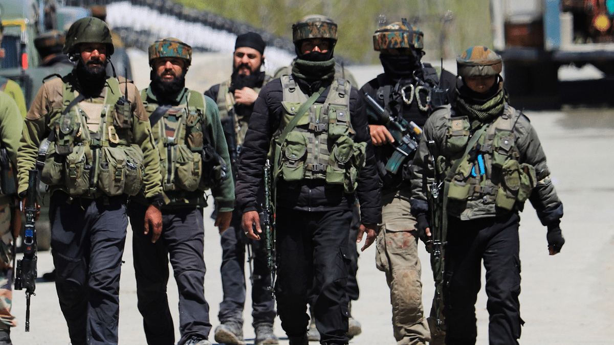 Army soldiers leave after an encounter with militants in the Pulwama district of South Kashmir. Three militants were killed in the encounter.