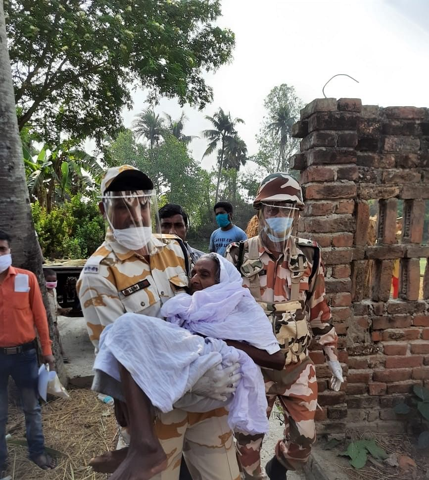 ITBP troops helping senior citizens in Kulpi, Sundarbans during the third phase of West Bengal Assembly polls on April 6, 2021.