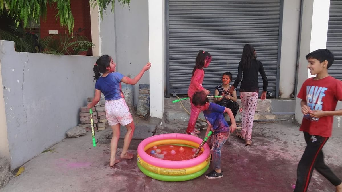 Children play with colours on Rangpanchami in Indore on Friday