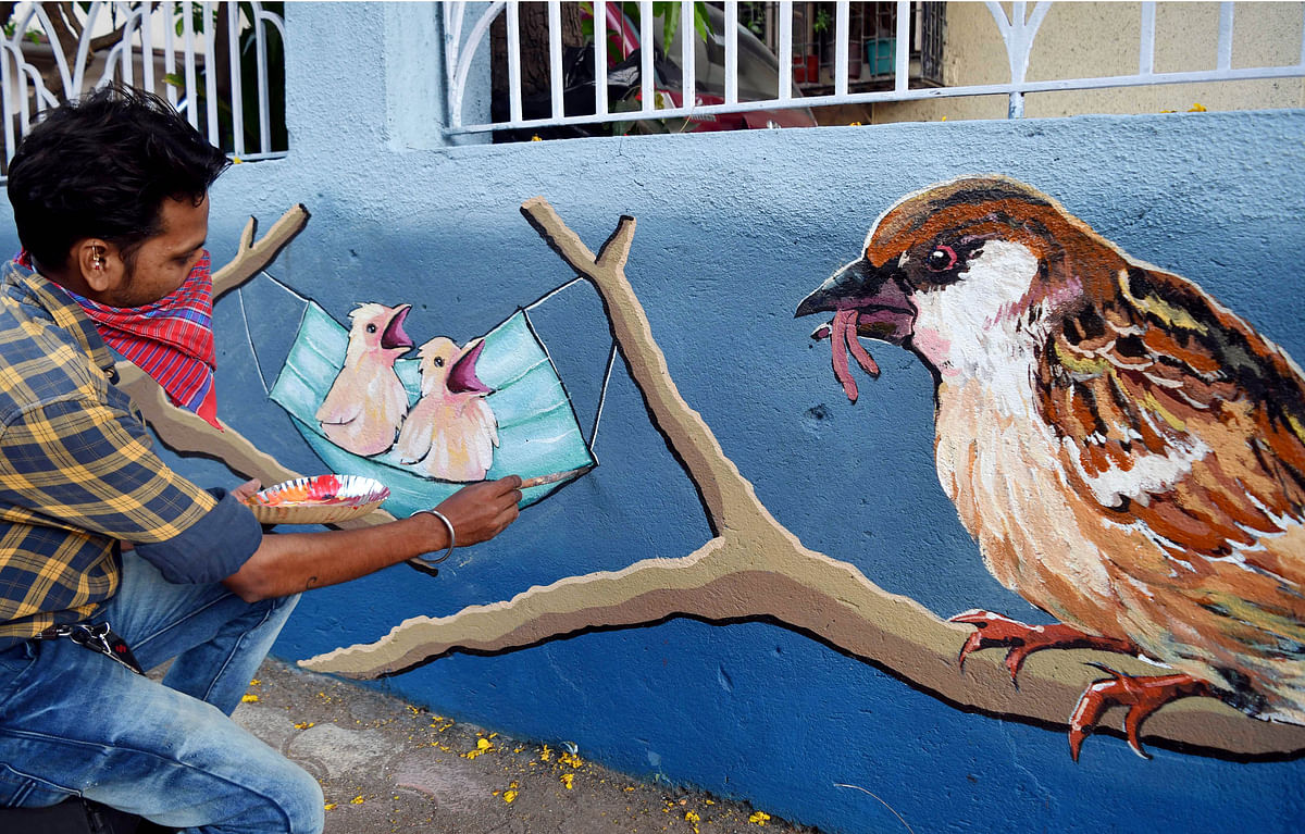 Maharashtra, April 04 (ANI): An artist makes a wall graffiti of a sparrow with an awareness message at Matunga, in Mumbai on Sunday.