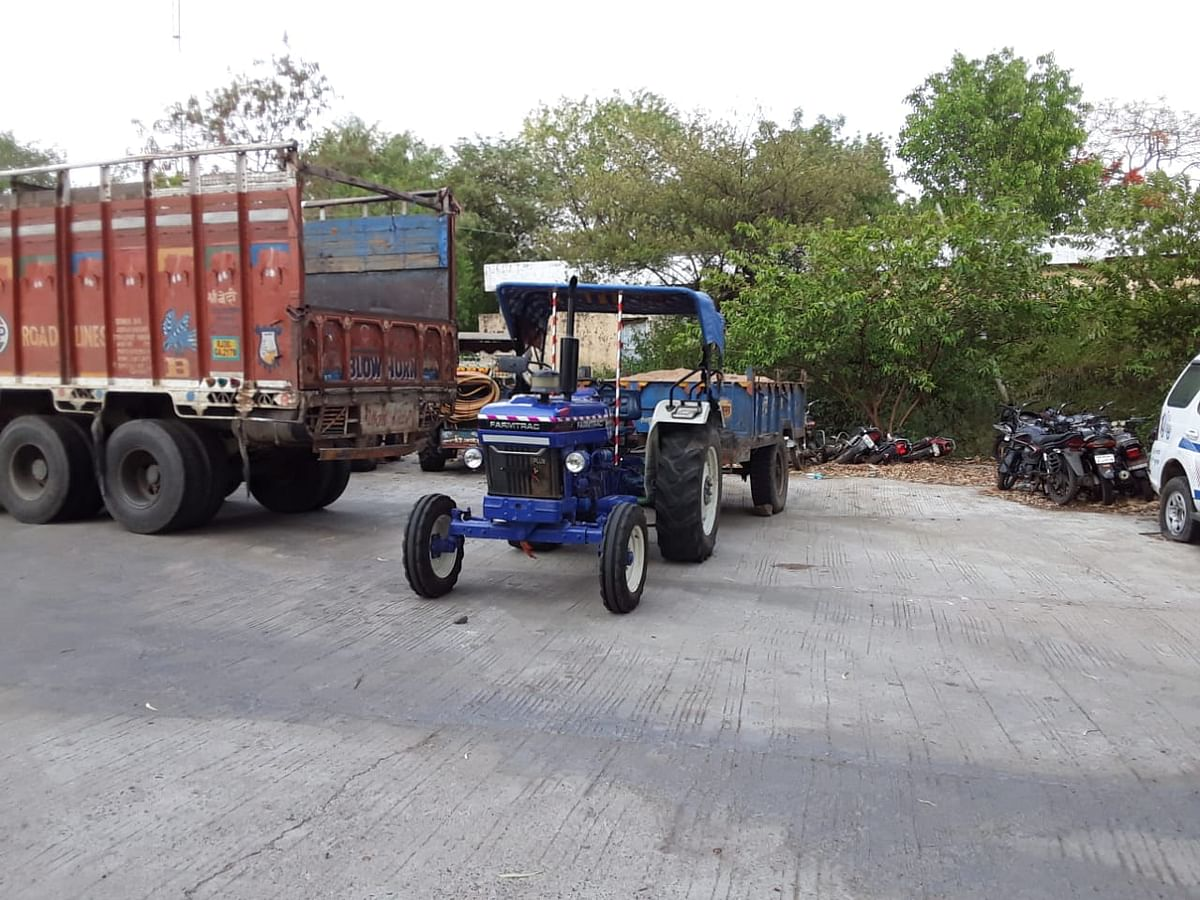 Seized tractor-trolley loaded with sand