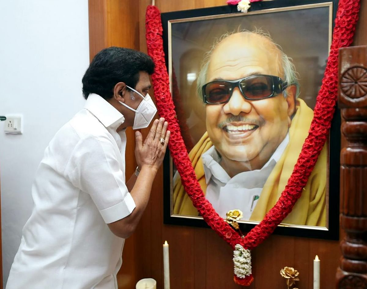 Newly-elected Tamil Nadu Chief Minister MK Stalin pays tribute to his father and former CM M Karunanidhi after taking oath ceremony, in Chennai on Friday.