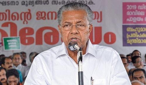 Vijayan cuts cake ahead of the beginning of second term