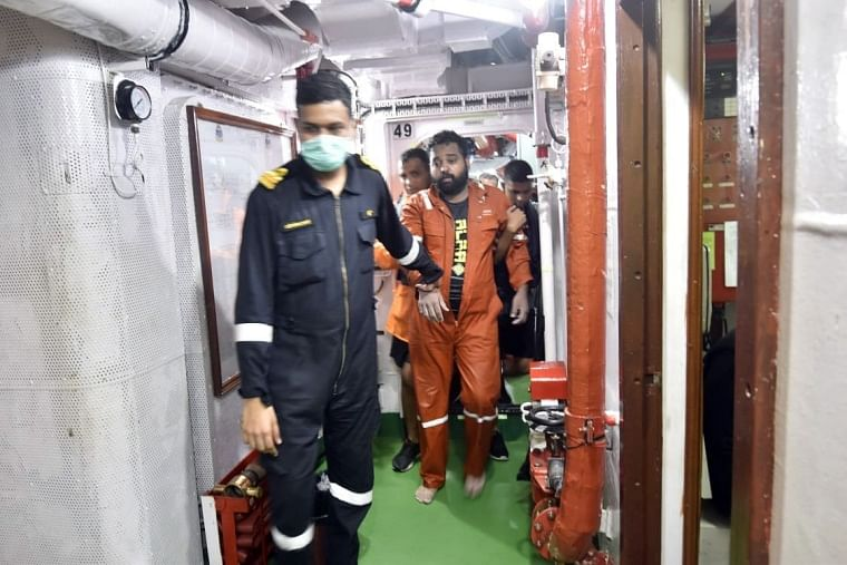 INS Kolkata conducting rescue operation during cyclone 'Tauktae' on the Mumbai coast on Thursday