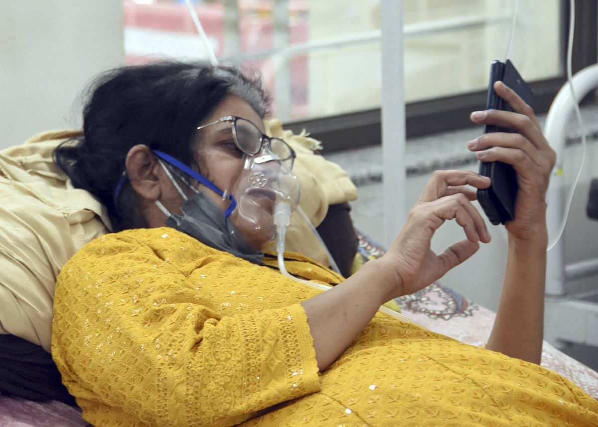 A COVID-19 patient on oxygen support receives treatment at Devji COVID-19 isolation centre, during the second wave of coronavirus in Jabalpur