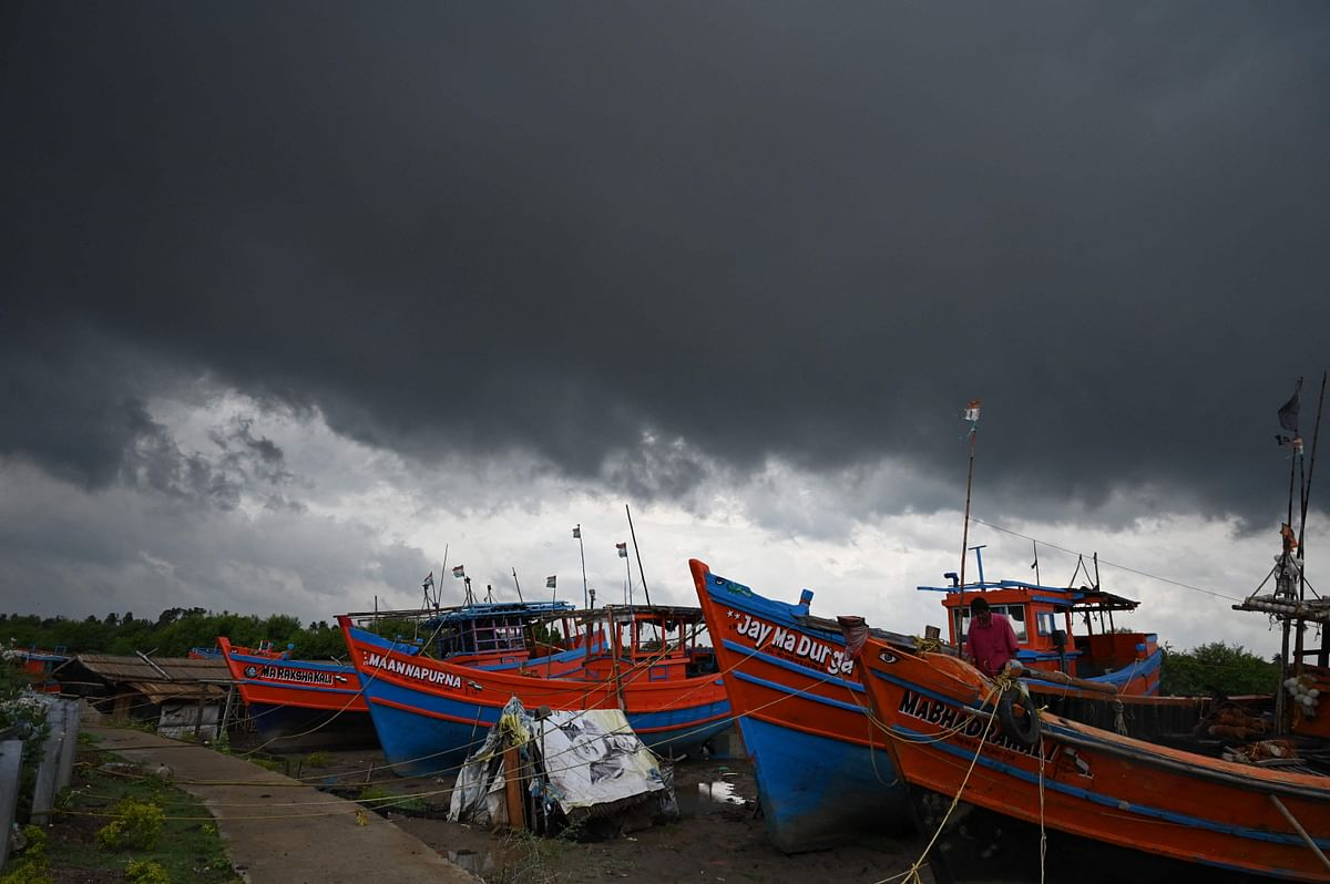 Dark clouds loom over fishing boats moored as Cyclone Yaas barrels towards Indias eastern coast in the Bay of Bengal where is expected to make a landfall tomorrow, in Digha some 190 Km from Kolkata on May 25, 2021.