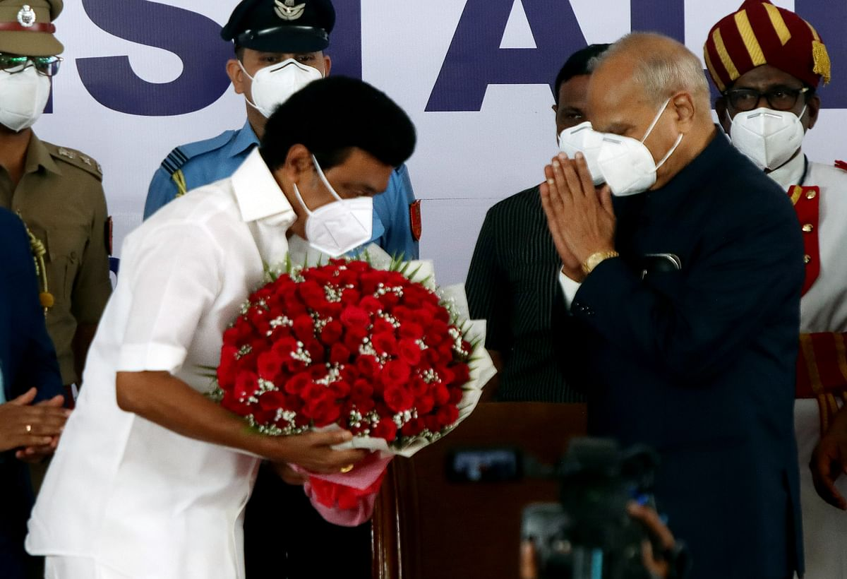 DMK Chief MK Stalin being felicitated with flowers by Governor Banwarilal Purohit following his oath ceremony as the Chief Minister of Tamil Nadu, at Raj Bhavan in Chennai on Friday.