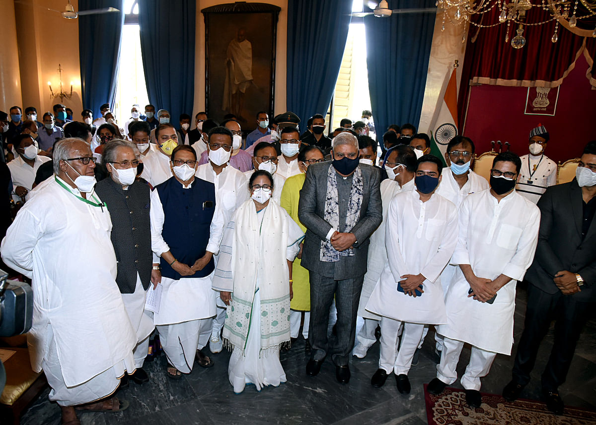 File/ Newly-elected for a third consecutive term Chief Minister of West Bengal Mamata Banerjee in a group photo with the party leaders, at Raj Bhavan in Kolkata on Wednesday. She was administered the oath by Governor Jagdeep Dhankhar.