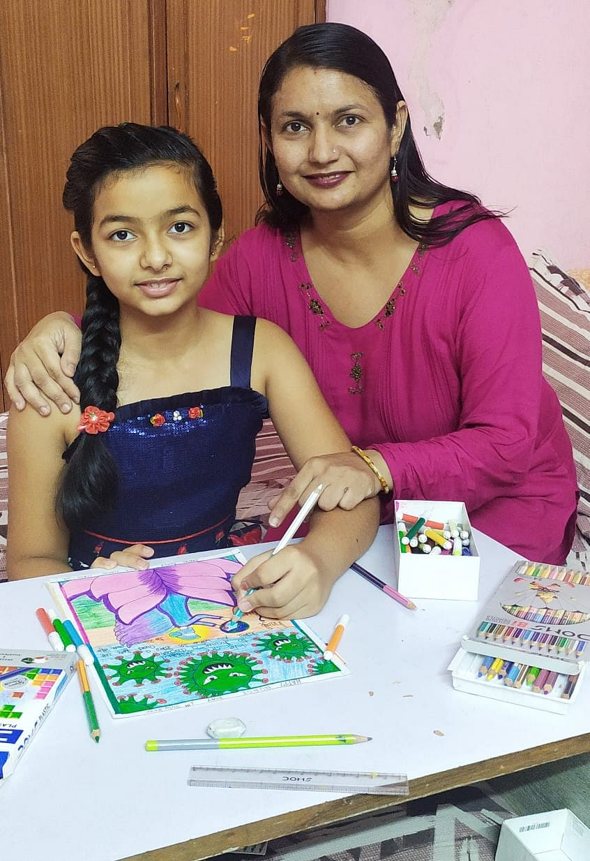 Deepal with her painting and her mother