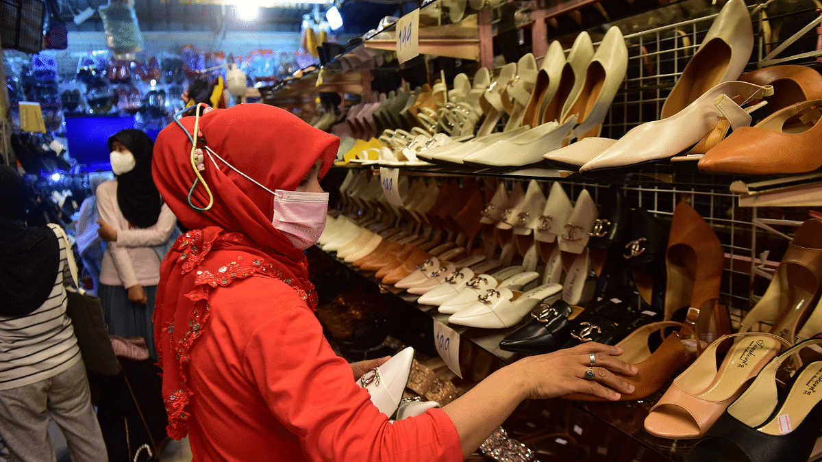 In Pics: Amid COVID-19 surge, preparation for festivities commence ahead of Eid ul-Fitr across Asia