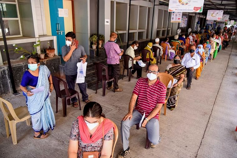 Citizens wait in a queue to receive a dose of COVID-19 vaccine, during the second wave of coronavirus epidemic in India, at ESIS Hospital in Navi Mumbai, Thursday, May 13, 2021