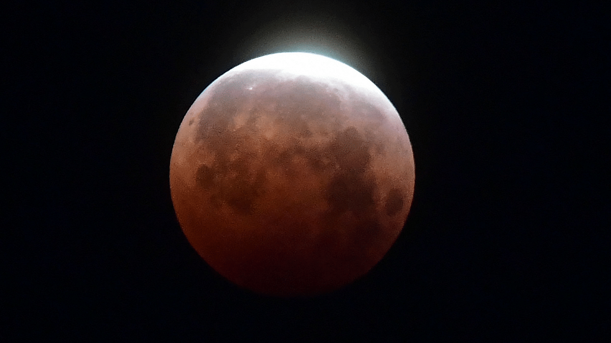 Super rare 'Super Blood Moon' lights up skies across globe; see pics