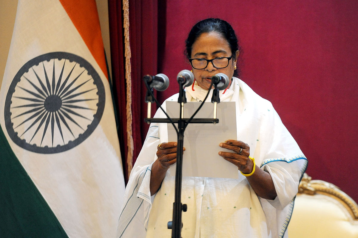 TMC supremo Mamata Banerjee takes oath as Chief Minister of West Bengal for a third consecutive term, at Raj Bhavan in Kolkata on Wednesday. She was administered the oath by Governor Jagdeep Dhankhar.
