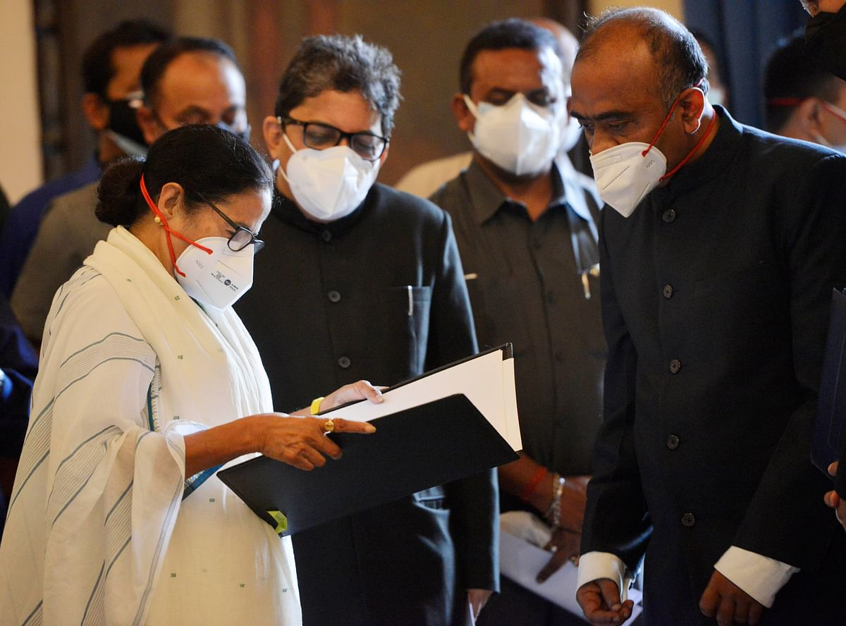 TMC supremo Mamata Banerjee before taking oath as Chief Minister of West Bengal for a third consecutive term, at Raj Bhavan in Kolkata on Wednesday. She was administered the oath by Governor Jagdeep Dhankhar.