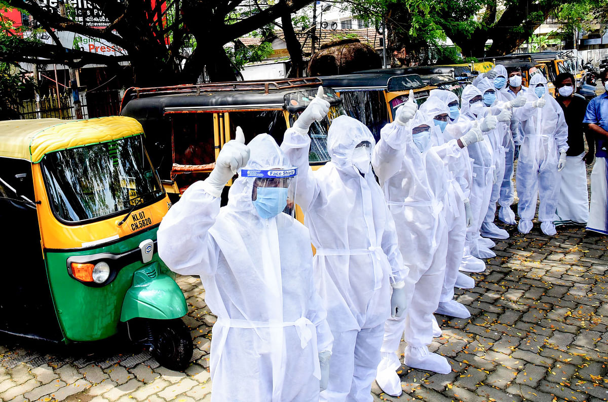 The Auto Ambulance drivers pose for a photo before begining their journey to help the COVID-19 patients in Kochi, Monday, May 24, 2021.