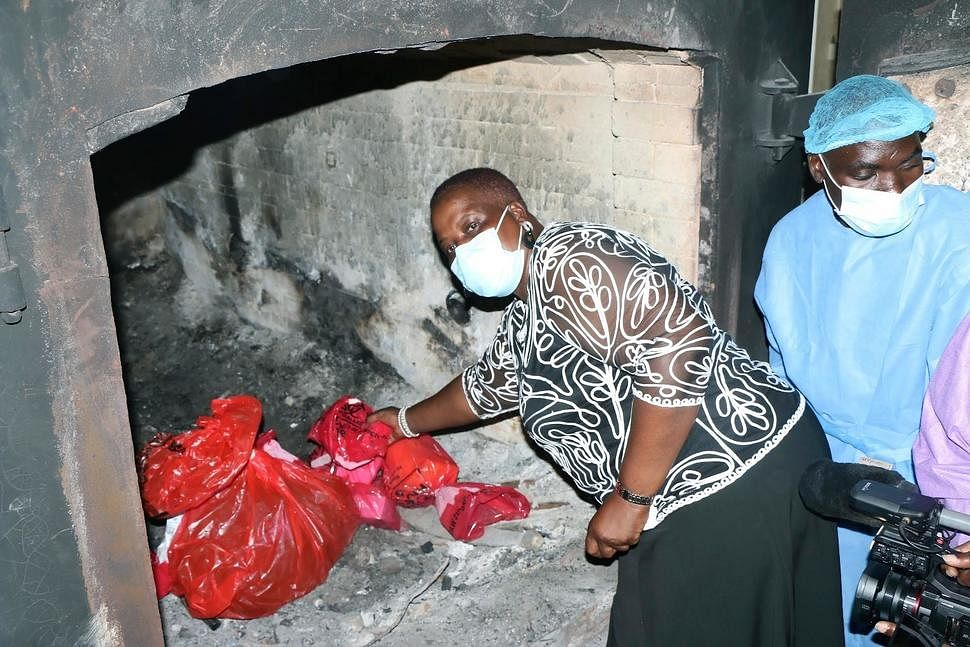 Malawi's Minister of Health Khumbize Chiponda, places COVID-19 vaccines in an incinerator, in Lilongwe, Malawi on May 19, 2021. The government incinerated over 19,000 doses of the vaccine at Kamuzu Central Hospital in the capital Lilongwe. According to Health Secretary Charles Mwansambo, the vaccines were the remainder of 102,000 doses that arrived in Malawi on March 26 with just 18 days until they expired on April 13.