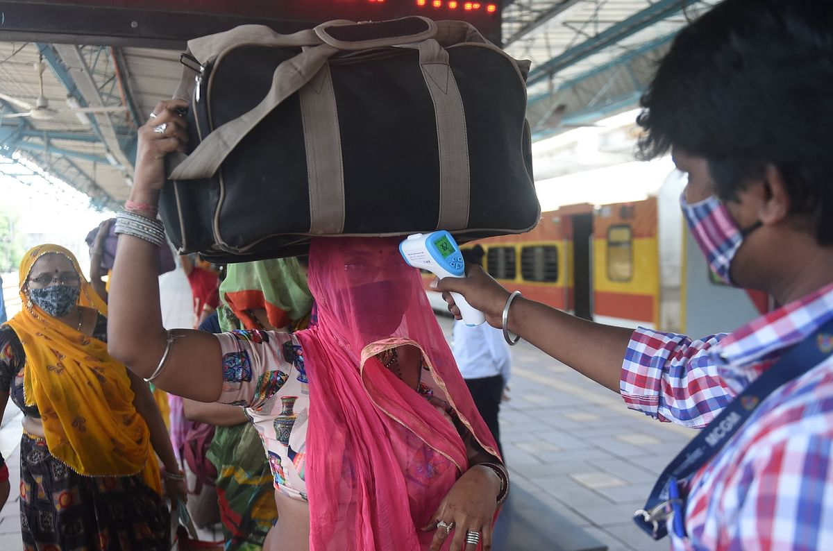 Mumbai: A BMC health worker does screening of a passenger for COVID-19 test at a railway station in Mumbai, Monday, May 24, 2021.