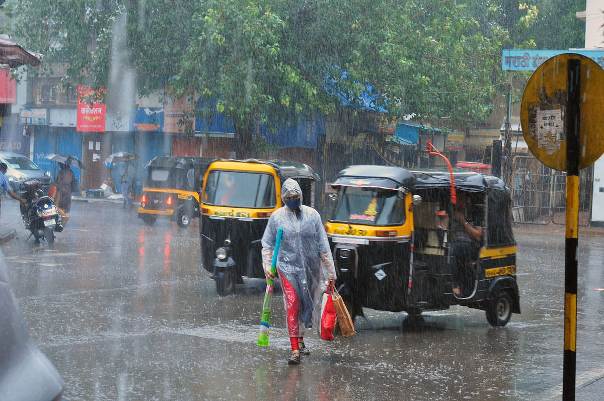 Maharashtra, May 17 (ANI): Commuters make their way during rainfall and strong winds triggered by cyclone Tauktae, in Thane on Monday.