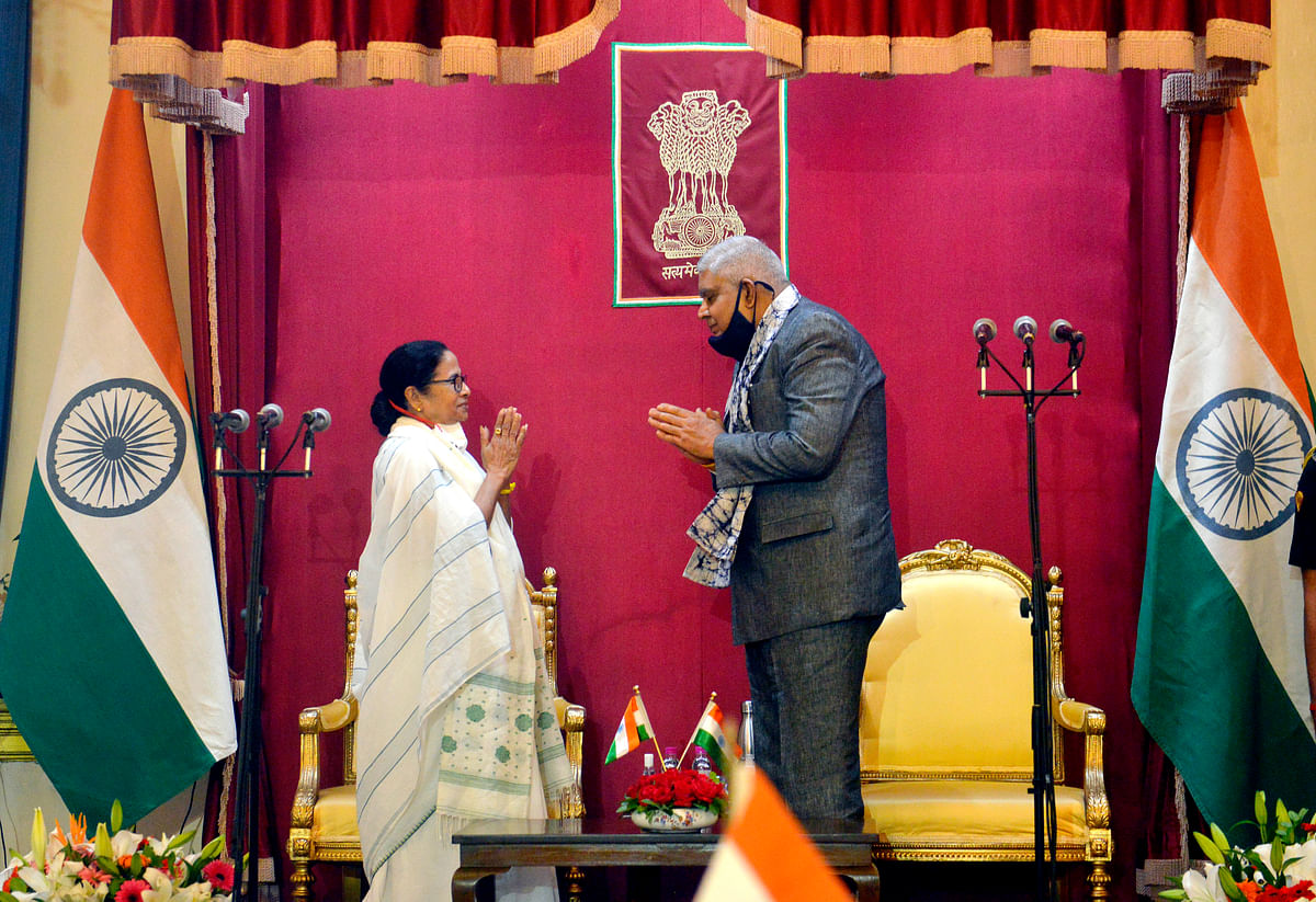 TMC supremo Mamata Banerjee makes a gesture to Governor Jagdeep Dhankhar after taking oath as Chief Minister of West Bengal for a third consecutive term, at Raj Bhavan in Kolkata on Wednesday.