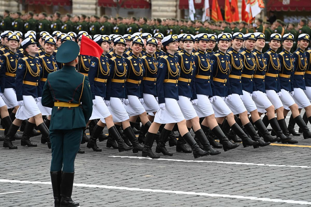 Russian servicewomen march along Red Square during the Victory Day military parade in Moscow on May 9, 2021.