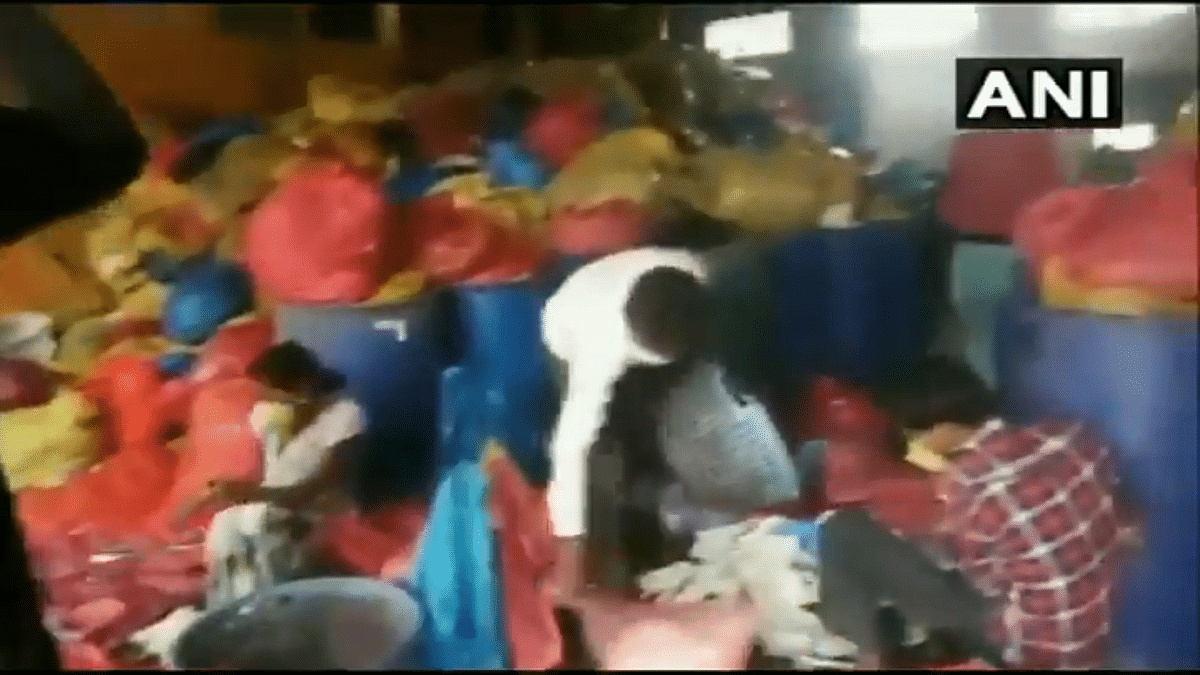 Video of used PPE kits, masks being 'washed for resale' in Madhya Pradesh goes viral; officials clarify