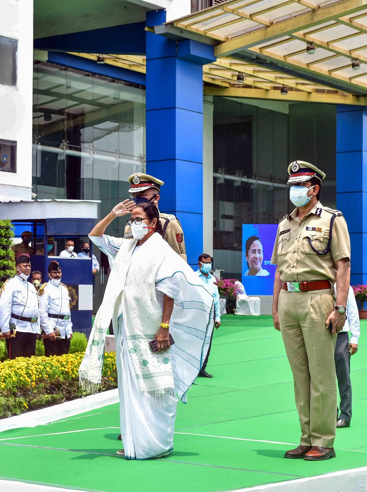 West Bengal Chief Minister Mamata Banerjee inspects a guard of honour on her arrival at her office after her swearing-in ceremony, at Nabanna in Kolkata, Wednesday, May 5, 2021.